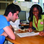 Example image of a student getting help from a staff-member